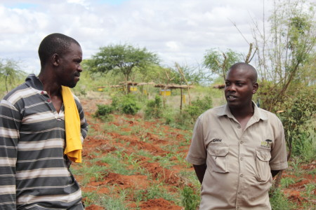 KING Augustine with farmer in beehive fence farm
