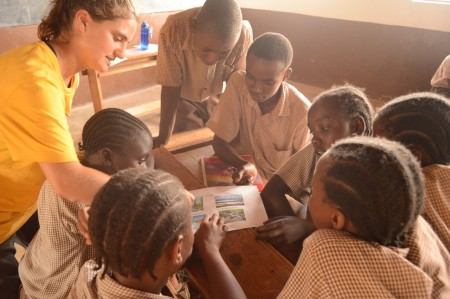 Intern Sasha with group of school children