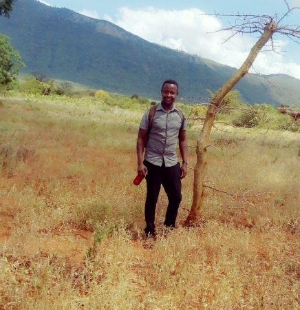 Photo of me in the field with Sagalla Hill in the background