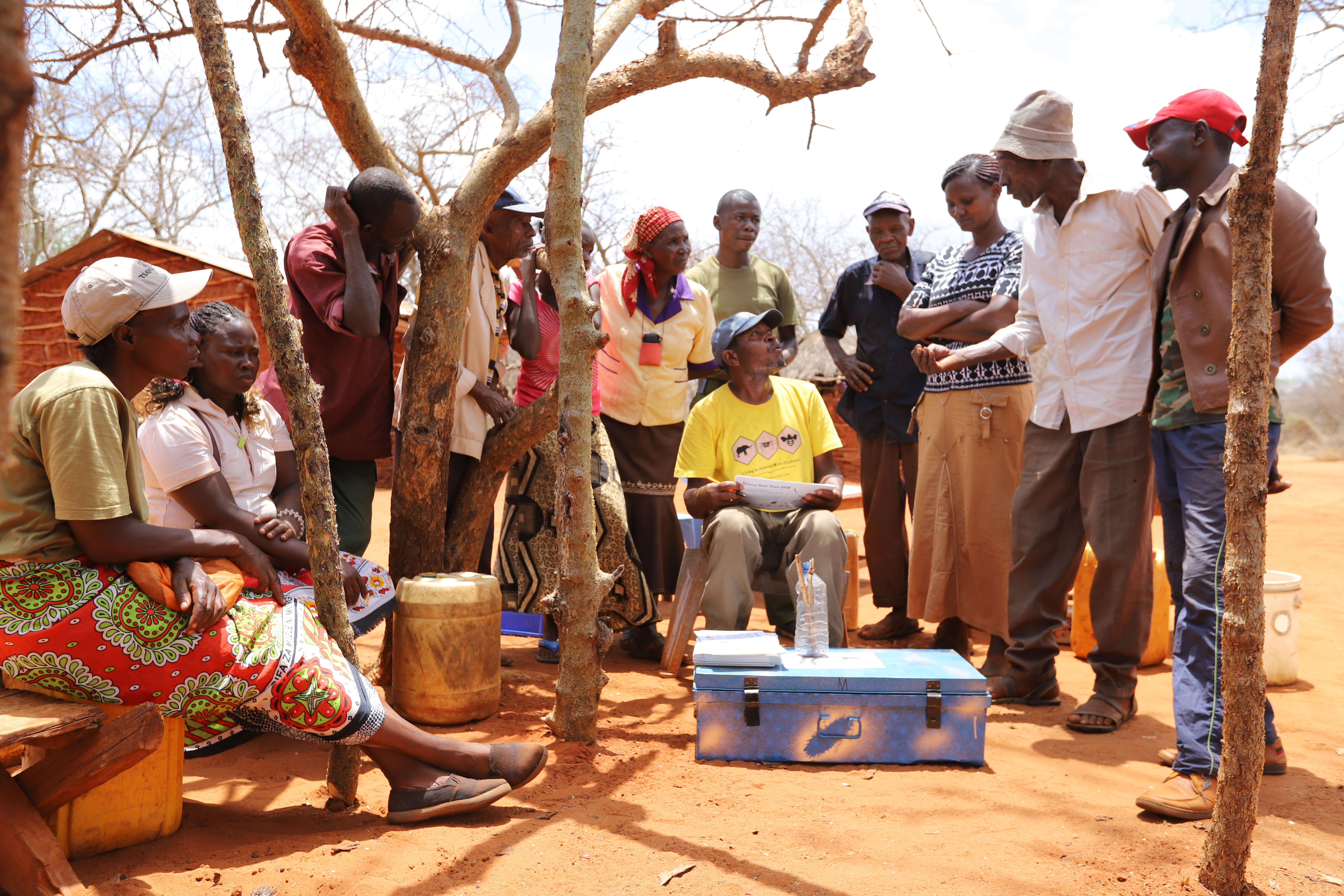 Emmanuel-training-the-farmers-how-to-fill-in-the-different-data-sheets-after-beehive-fence-construction-in-Kamungi-Conservancy-Tsavo-Trust2-©-2018-Naiya-Raja